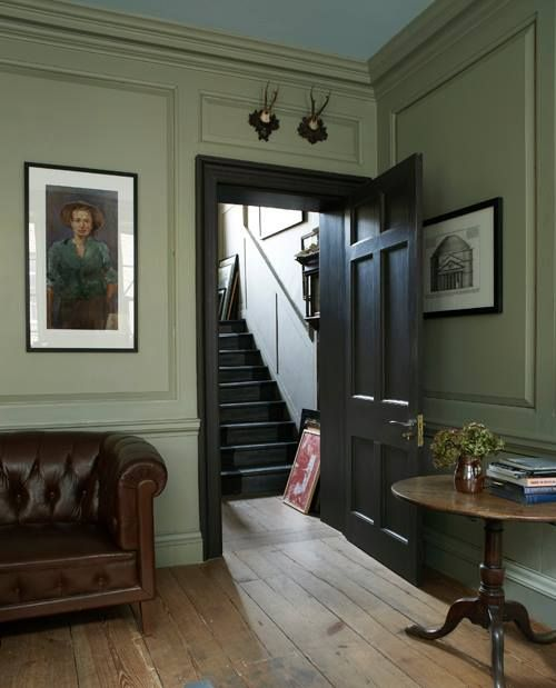 An early Georgian home with walls, skirting and panelling in French Gray, with the doorway brought to prominence using the rich, dark tones of Mahogany