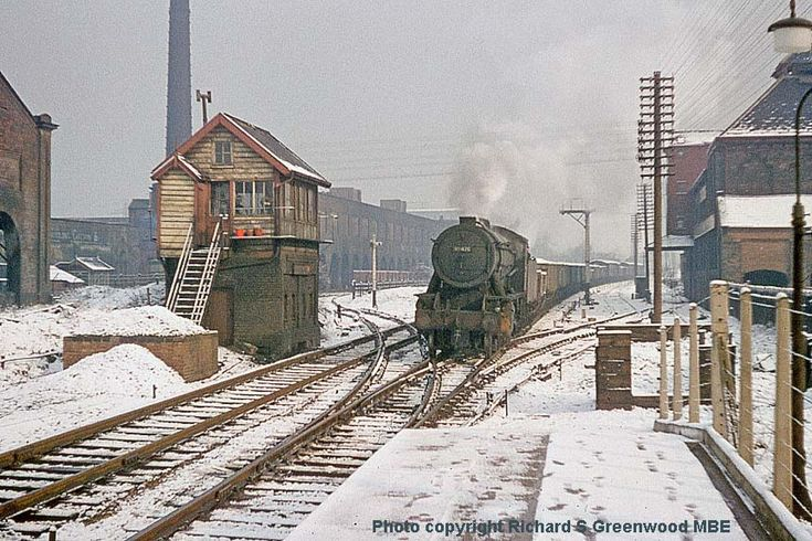 This shot of a WD 2-8-0 No 90470 in the snow at Castleton station has a wealth of detail. The locomotive was shedded at both Wakefield (56A) and at Sowerby Bridge (56E) during the 1960s. The train is a mixed freight rather than a block coal train so is probably from Healey Mills and is heading for Moston Sorting Sidings. The wan, midwinter, weak sunshine gives the shot a pleasing 'watercolour' effect, so much more attrative David Heys steam collection - 53 - RAIL CAMERAMAN GREENWOOD16