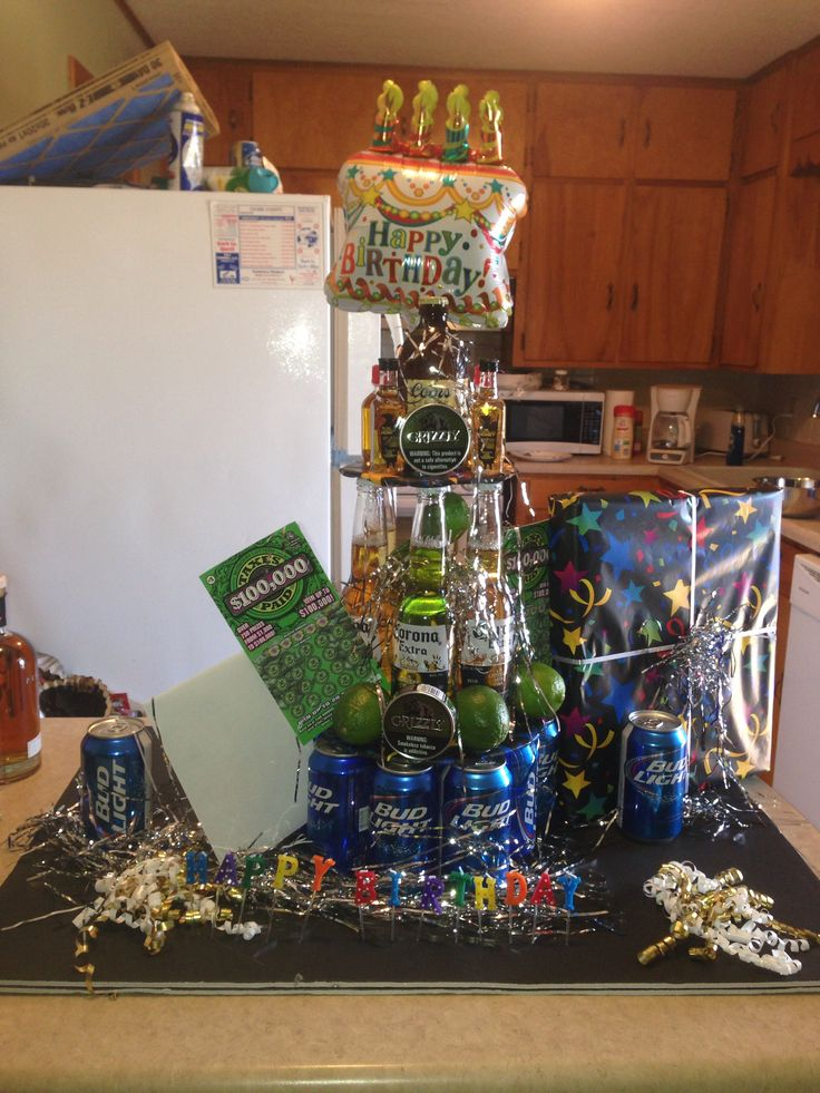 """This is a """"beer cake"""" that I made for my boyfriends birthday. Corona, bud light, coors, lottery tickets and chew:)"""