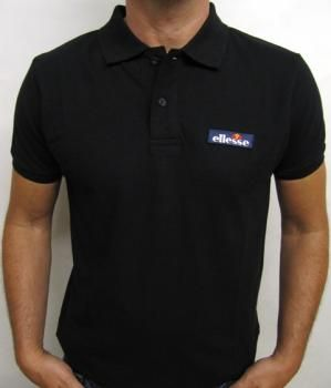 Ellesse Baseline Polo Shirt in Black  The Ellesse Baseline Polo Shirt is part of Ellesse Italia range of clothing that features the classic Ellesse single logo, with semipalla embroided onto the chest.  Made from 100% cotton the Ellesse mens baseline polo features some a subtle design with two button placket and ribbed cuffs.