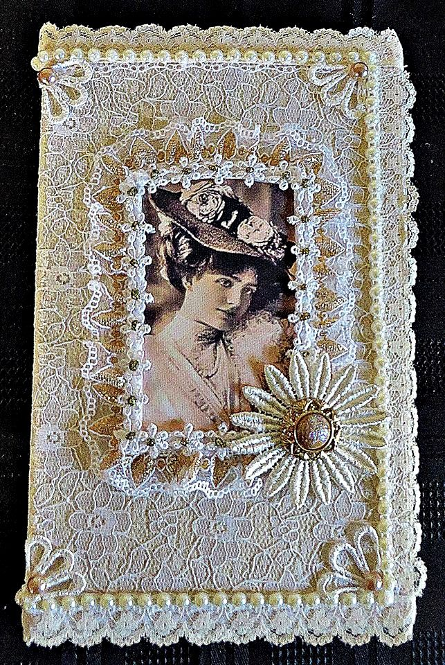Fabric and lace covered note book
