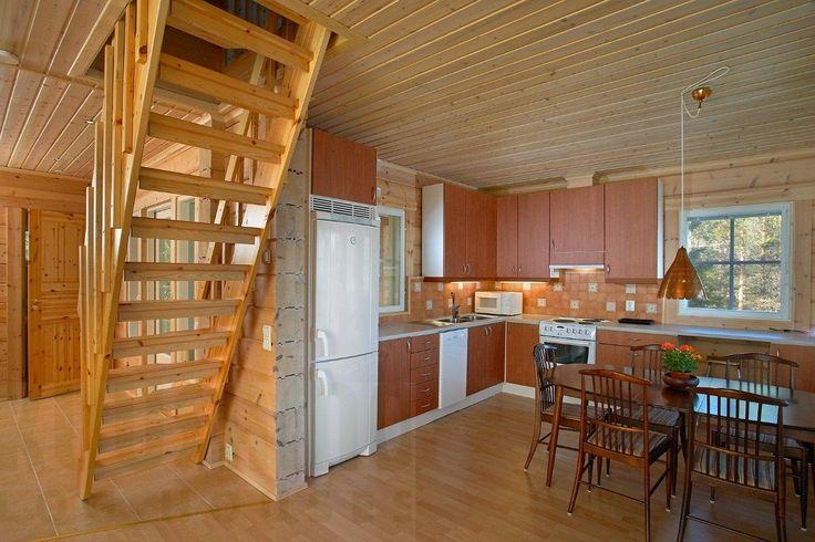 cocina casa de madera Kuusamo Log Houses modelo Meksus