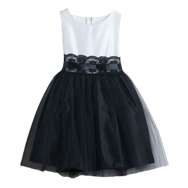 A beautiful dress for your little girl's special occasion by Sweet Kids. This sleeveless satin dress features a beautiful ivory top with lace adorned attached waistband and with a black skirt. The added crinoline underneath make this the perfect dress fo