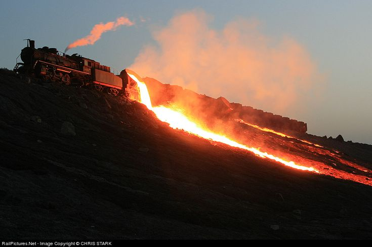 RailPictures.Net Photo: Baotou Steel Mill Railroad Steam 2-8-2 at Baotou, China by CHRIS STARK. Dumping slag.
