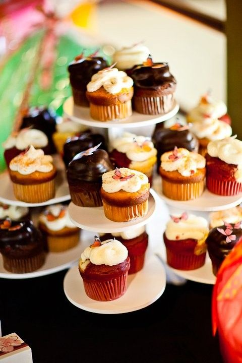 Wedding Flower Cupcake Tower Display: http://www.thesmartbaker.com/3-tier-flower-cupcake-tower/