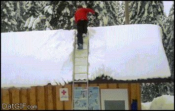 This amateur gymnast shoveling snow off his roof: | The 21 Luckiest People In The Entire World