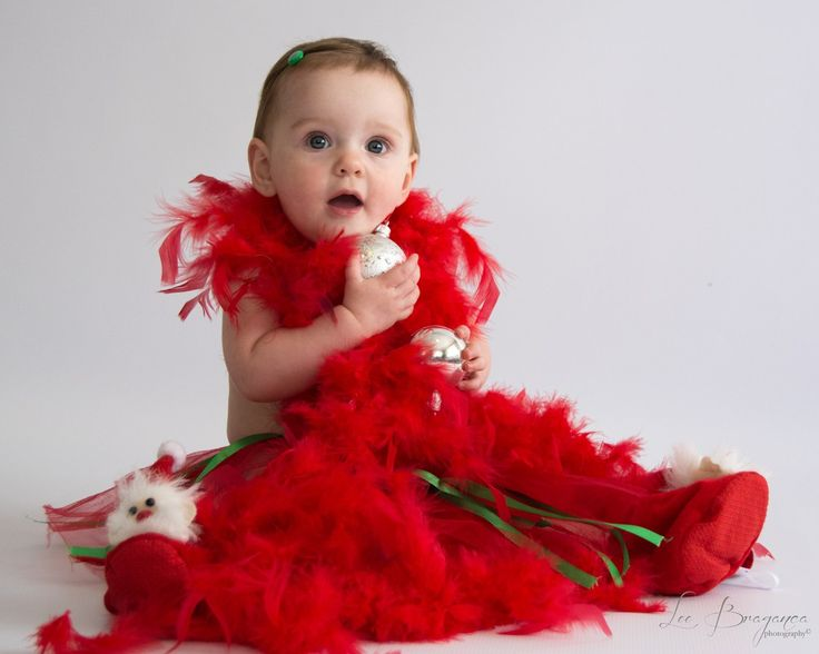 A photo of baby Natasha wearing a red fluffy scalf taken by Lee Braganca Photography