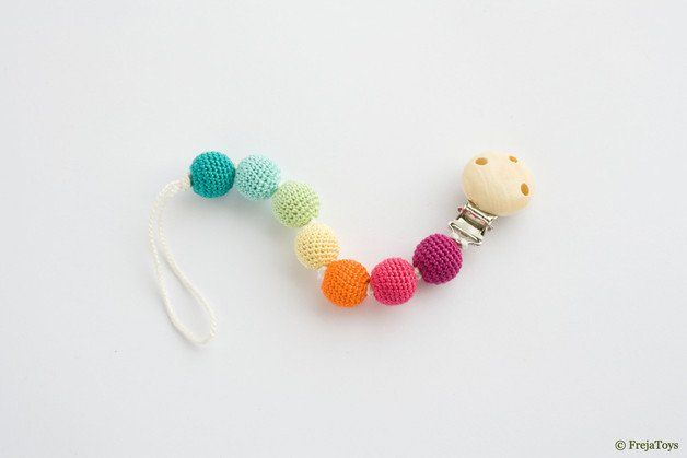 Dear Mommies, no more worrying about baby´s pacifier falling on the floor or getting lost! Attach it to baby's outfit, blanket, toy or even car seat or stroller. Chewing on these wooden beads...
