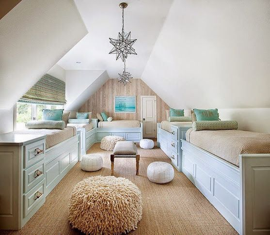 Attic sleeping quarters for homes that get a lot of overnight guests! You likely would not want to suddenly sit upright without first remembering where you are, but the odds are good that a young guest would be occupying one of these beds.