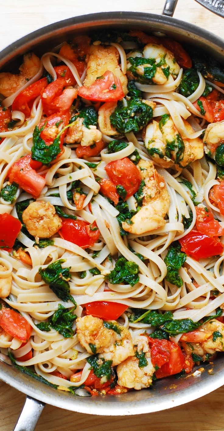 Shrimp pasta with fresh tomatoes and spinach in a garlic butter sauce. An Italian comfort food spiced just right! Includes gluten free option