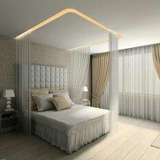 Zaclony kolem postele