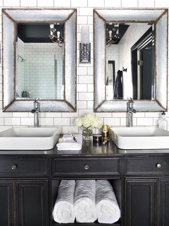 antique black vanity | zinc mirrors | subway tile & black grout