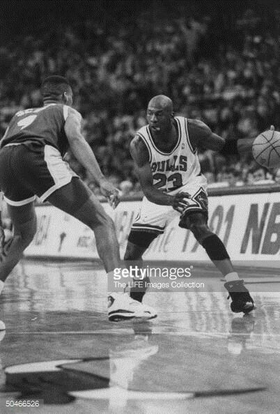 The GOAT gets into attack mode against the Lakers' Byron Scott during the 91 Finals in Chicago.
