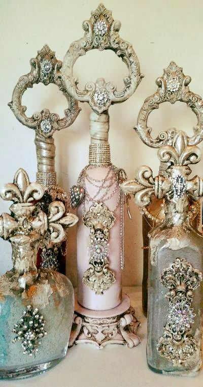 Three perfume glass bottles, each one different