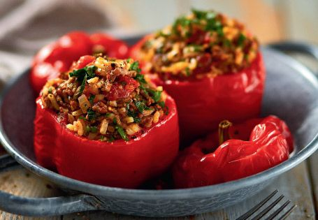 Capsicum Stuffed with Mince, Rice & Herbs ---- ¼ cup Olive Oil 1 large Brown Onion, finely diced 2 cloves Garlic, minced 500g Beef Mince 2 cans crushed Tomatoes 1 tbsp dried Oregano 1 tsp ground Cinnamon 3/4 cup uncooked White Rice 6 Capsicums 500ml Chicken Stock ___ oven to 190°C, 1½ - 1¾ hrs