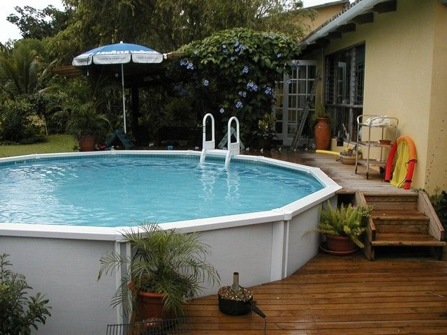 133 best images about pools tiki bars on pinterest for Above ground pool decks with bar