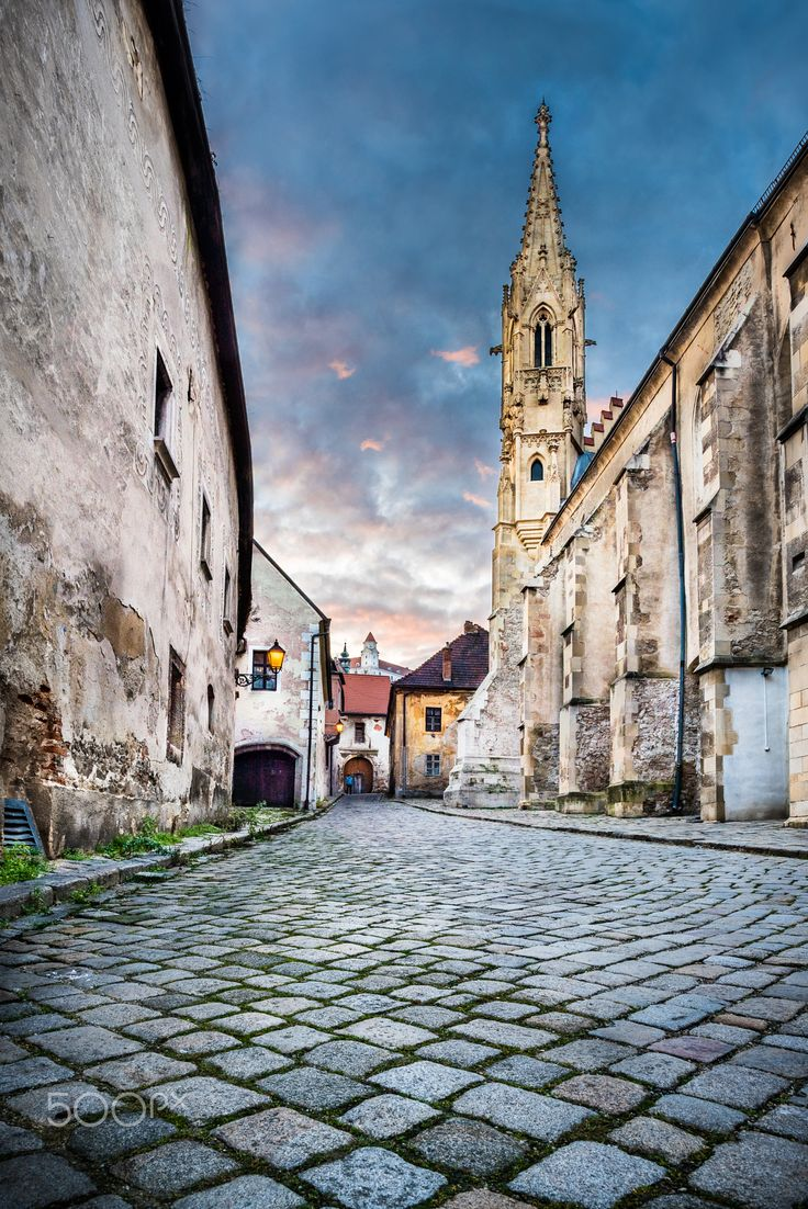 The old town street - Farska street in Bratislava, with one of the gothic landmarks of the city, the Clarissine Church, that is currently used as a concert and exhibition hall.