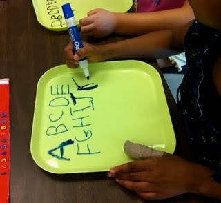 CHEAP dry erase boards= plastic plates from IKEA- 4 for $1.99
