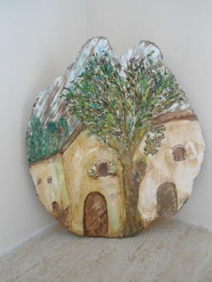 a village painting  on an olive wood