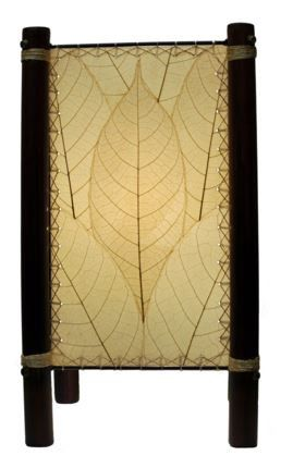 Natural Fortune Table Lamp. The Fortune lamp is made from real leaves and gets its name because of the sturdy bamboo legs as bamboo is a sign of good luck in many Asian cultures. It is made sustainable for the environment and is fair traded. Featuring real cocoa leaves and a simple square design, this lamp is a true show piece and conversation starter. We recommend using either 1 compact florescent light (CFL) bulb or 1 LED bulb.