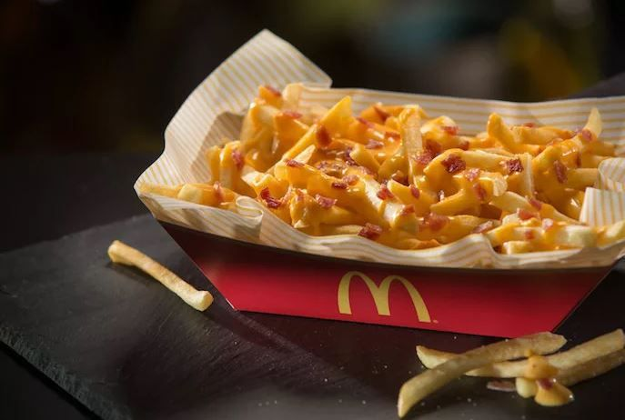 In cities across the US, McDonald's branches have been trialing cheese and bacon covered fries.