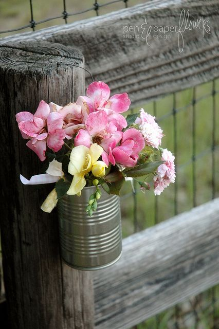 flowers in an empty tin soup can, so cute.