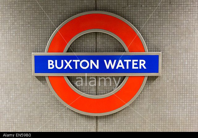 Buxton Water TFL sign at Canada Water station on the 26th April 2015 Stock Photo