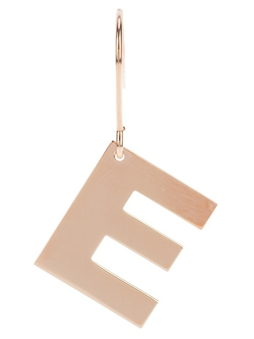 Metallic silver earring from Maman et Sophie featuring a large letter pendant and a hook fastening.