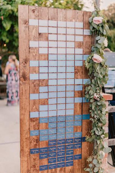 An ombré-inspired seating chart is such a fun way to work Serenity Blue into your wedding.