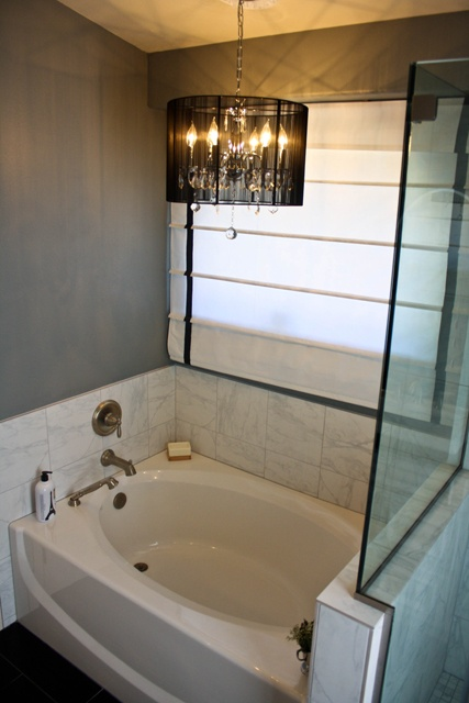 master bath update...as long as an inspector doesn't see....love the chandelier above the tub!