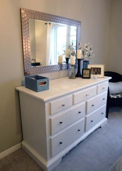 I love the idea of a wall-mounted mirror over a DIY painted dresser as an alternative to a vanity or dresser w/ attached mirror. Looks clean and modern!