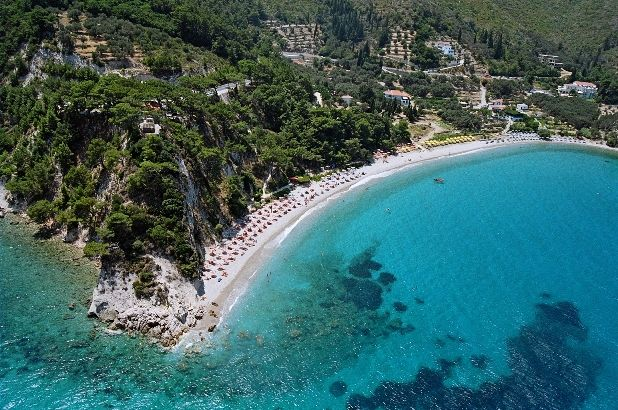 Aerial view of Tsamadou beach, Armonia bay hotel sits on the picture's right end. Kokkari, Samos, Greece