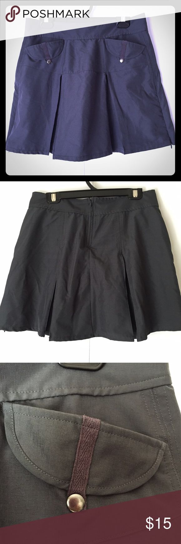 "Freedom Trail - Dark Grey Skort - S Take a hike in this skort or wear it to run or play tennis! This versatile skort has built in shorts and 2 front pockets. You can make the skirt flair more by unzipping both sides of the skirt (zipper 7""). Measured flat: 15"" waist; 16"" length & 2"" inseam shorts. Body: 92% Polyester, 8% Spandex; Lining: 88% Polyester, 12% Spandex Freedom Trail by Kyodan Shorts Skorts"