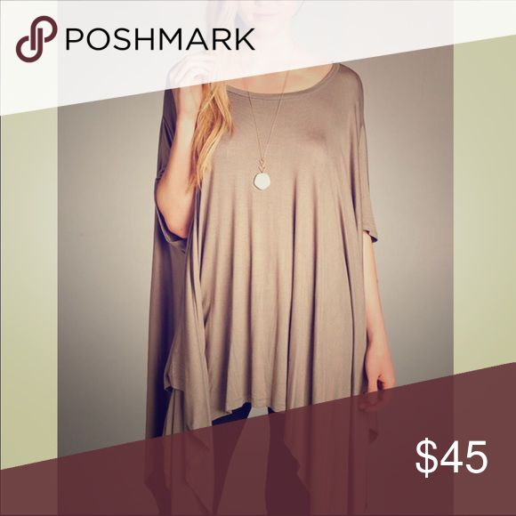 COMING SOON: Asymmetrical tunic top COMING SOON: asymmetrical tunic top. Go to piece for on the go or night on the town! Pair with shorts + gladiators/booties or military boots! OR: skinnys + your best heel/wedge. Rayon/spandex. Tops