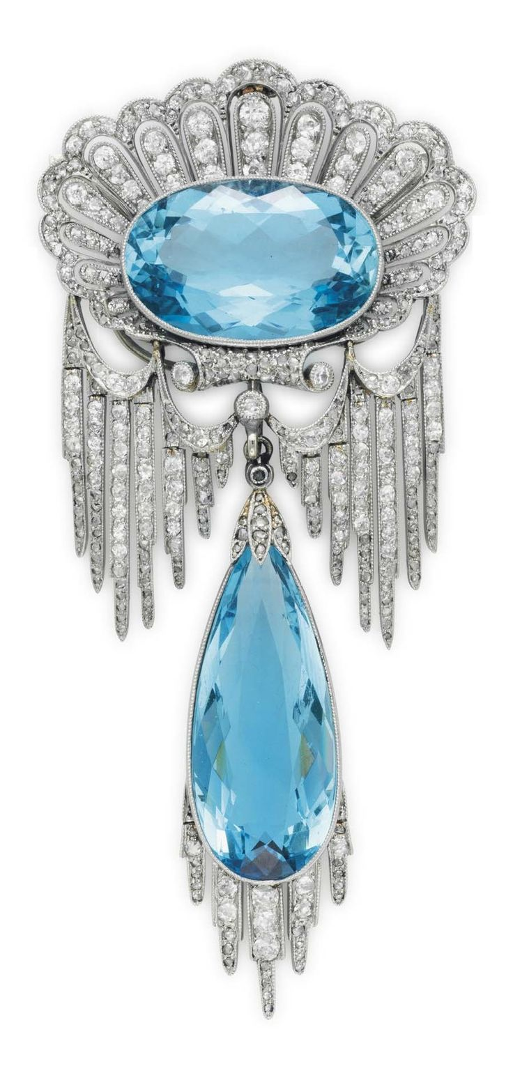 CHAUMET - A BELLE EPOQUE DIAMOND AND AQUAMARINE PENDANT BROOCH, CIRCA 1910. Designed as an openwork scalloped shell with faceted aquamarine centre suspending a festoon of graduated diamond and rose-cut diamond 'stalactite' drops, the elongated aquamarine drop with short diamond-set fringe en suite, unsigned.