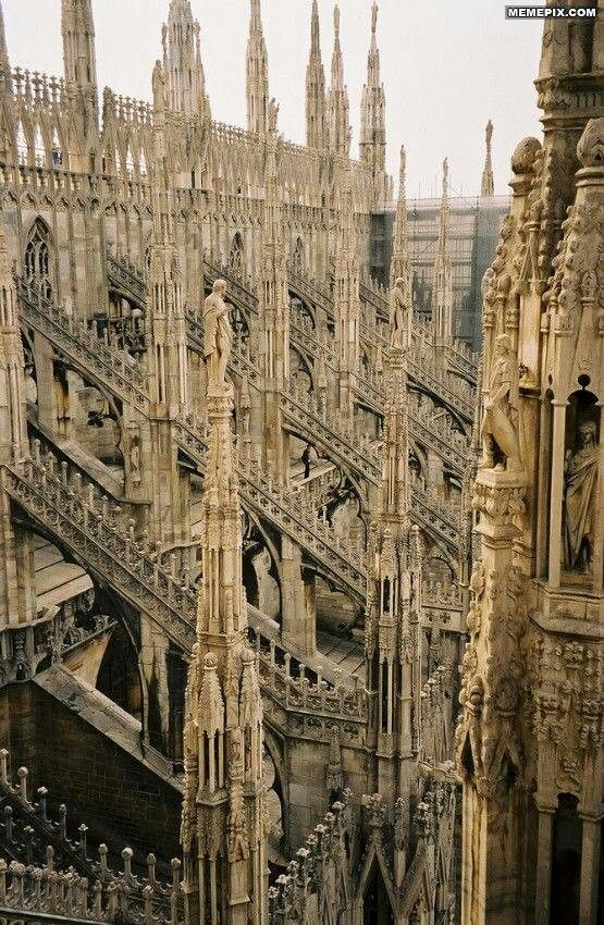 Milan Cathedral is in Gothic Architecture, Saw this documentary & the roof is open to the  public kinda cool.