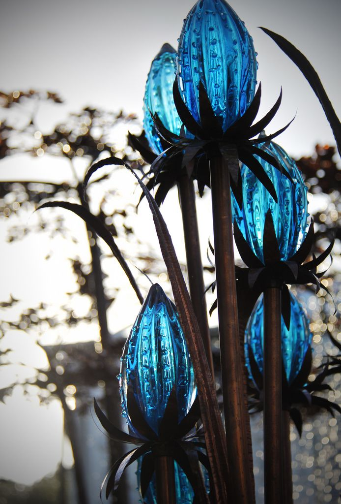 brilliant blue glass protea - chelsea flower show 2011 in london, england  These would make great garden lanterns.