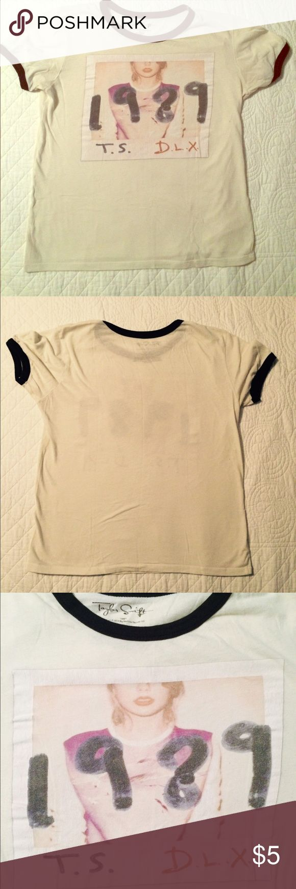 Taylor swift album cover top. Cute Taylor swift 1989 album cover tee, it is a natural color with a black neckline and sleeves. If you require any further information, let me know. Taylor Swift  Tops Tees - Short Sleeve