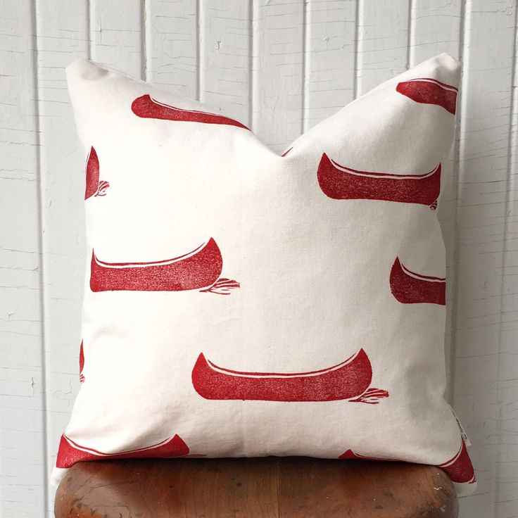 A top choice - the red canoe pillow! https://www.etsy.com/ca/listing/501700118/organic-canvas-with-red-canoes-18-square
