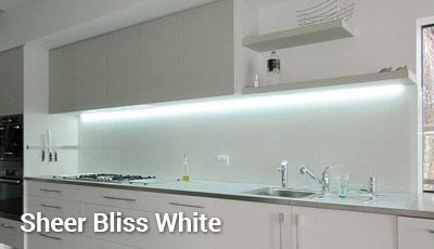Reflection Splashback in Sheer Bliss White adjoining bench tops and oven.