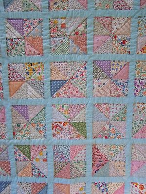Scrappy 30's  fabric quilt. Made from antique blocks. Lovely and simple.
