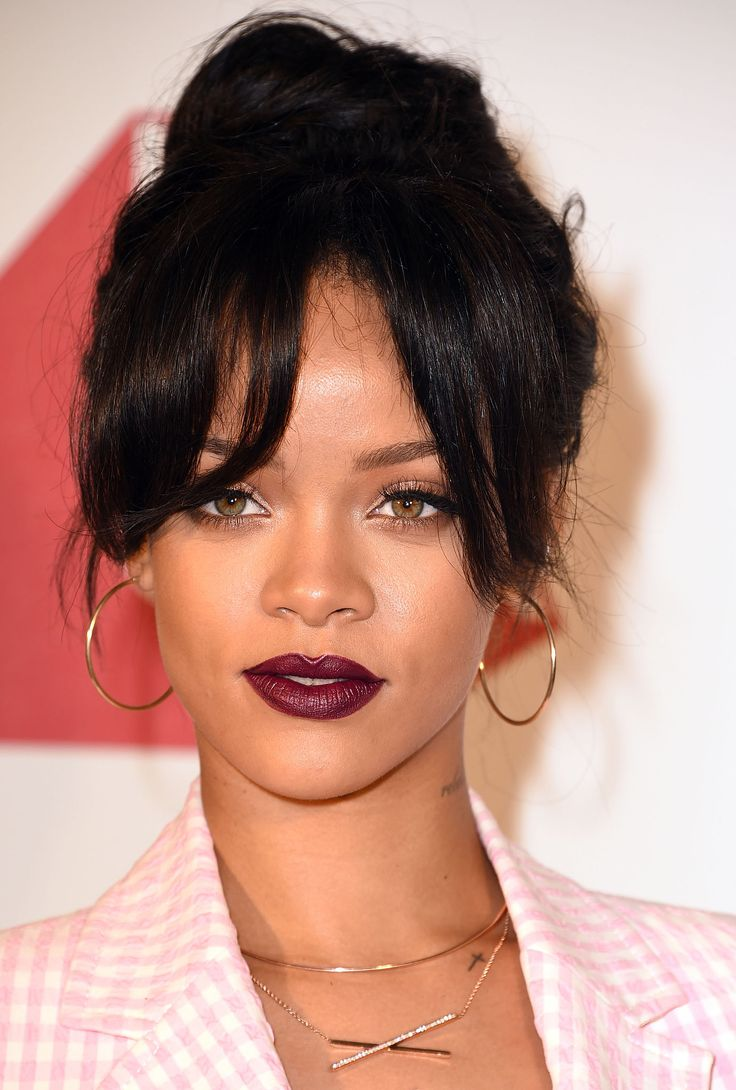 At the MAC Cosmetics premiere of It's Not Over, Rihanna wore a black cherry lipstick that made her hazel eyes look even brighter.