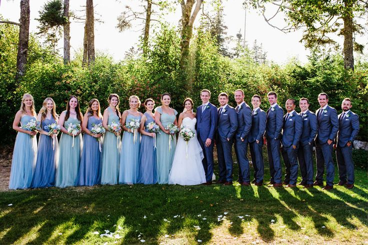 A coastal chic Maine wedding with mix and match blue bridesmaids and nautical inspired details.