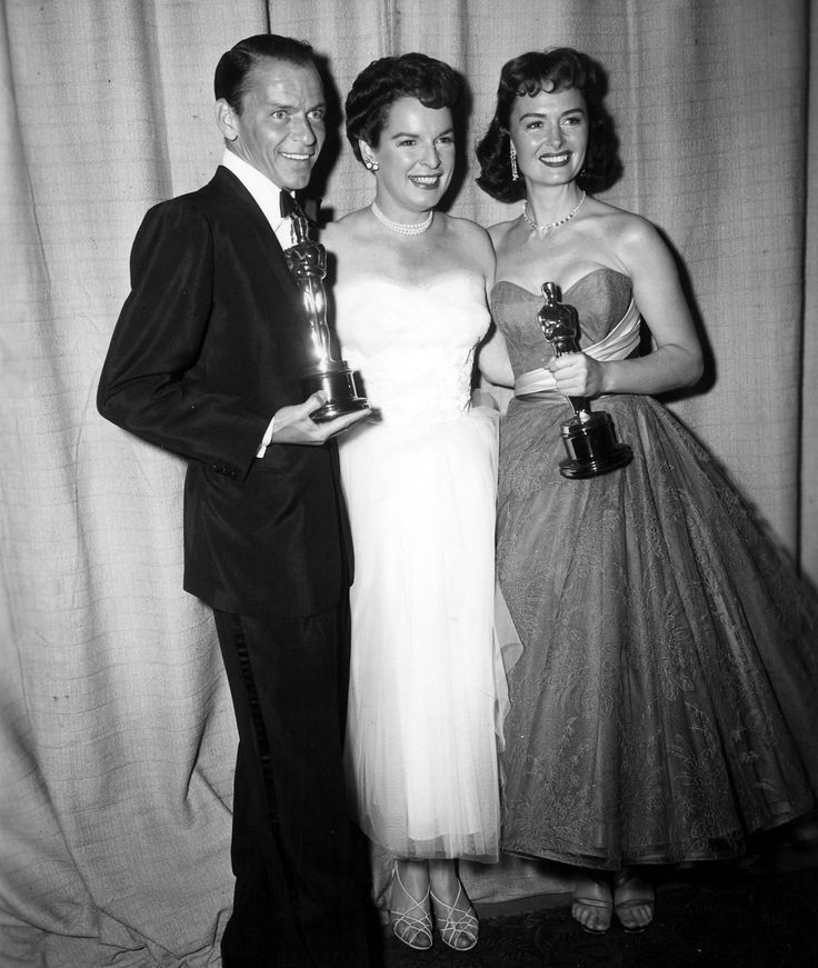 Marcedes McCambridge giving Frank Sinatra & Dona Reed their Oscars for Best Supporting Actor and Actress