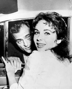 Elizabeth Taylor smiles happily on leaving Columbia Presbyterian Hospital as husband, Michael Todd holds her hand before joining her in car. Elizabeth gave birth to a daughter by Caesarean operation. Elizabeth Frances born on 8/6 is doing 'just wonderful' according to her mother, will remain at the hospital.Photo by John Peodincuk August 19, 1957