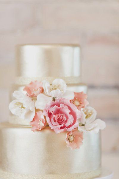 Gorgeous metallic wedding cake with pink, white, and coral flowers. Modern yet timeless.