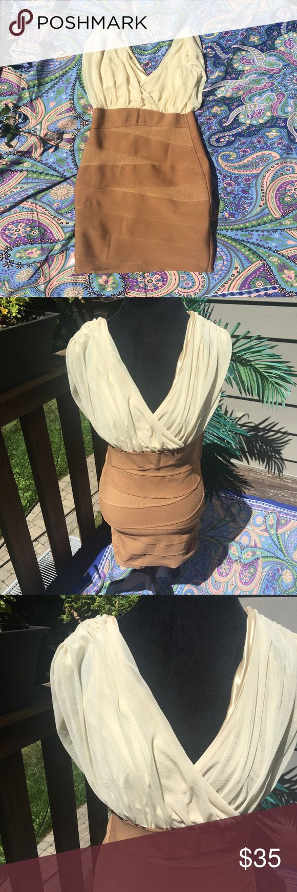WoW couture | Jamie Dress Beautiful dress with tan pencil skirt bottom and a beautiful blouse top. Has a side zipper on the side and a little snap on the front. Like new condition. Size medium. WOW couture Dresses Midi