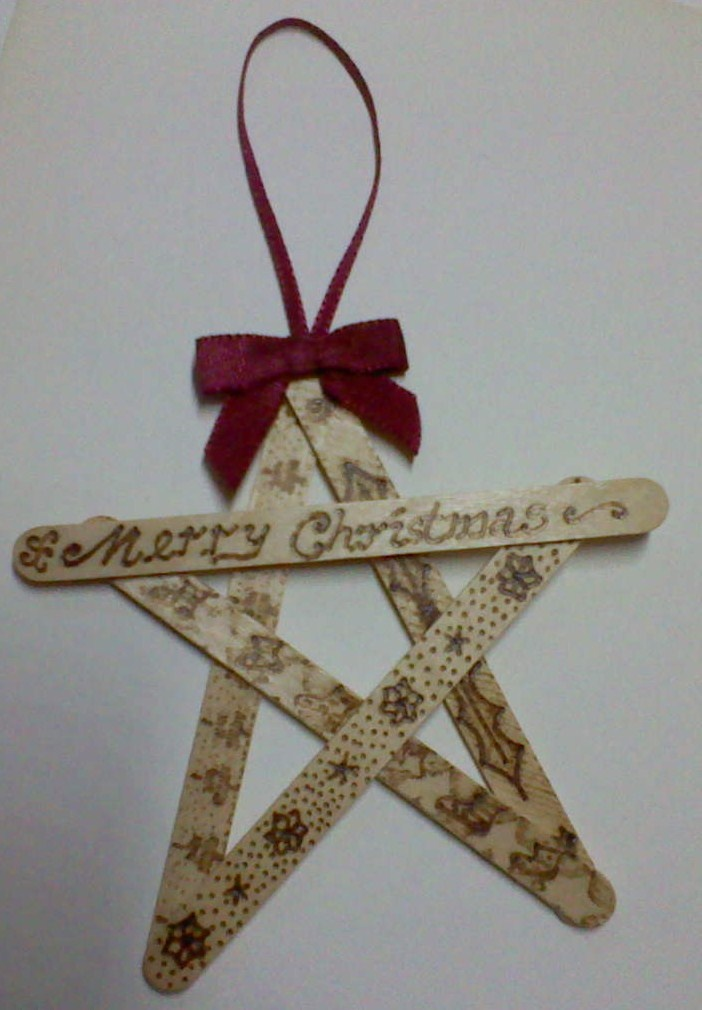 Lolly stick Christmas decoration.  Shani Burgess Pyrography on wood.
