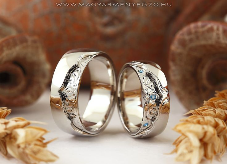 White gold wedding rings with blue diamonds.