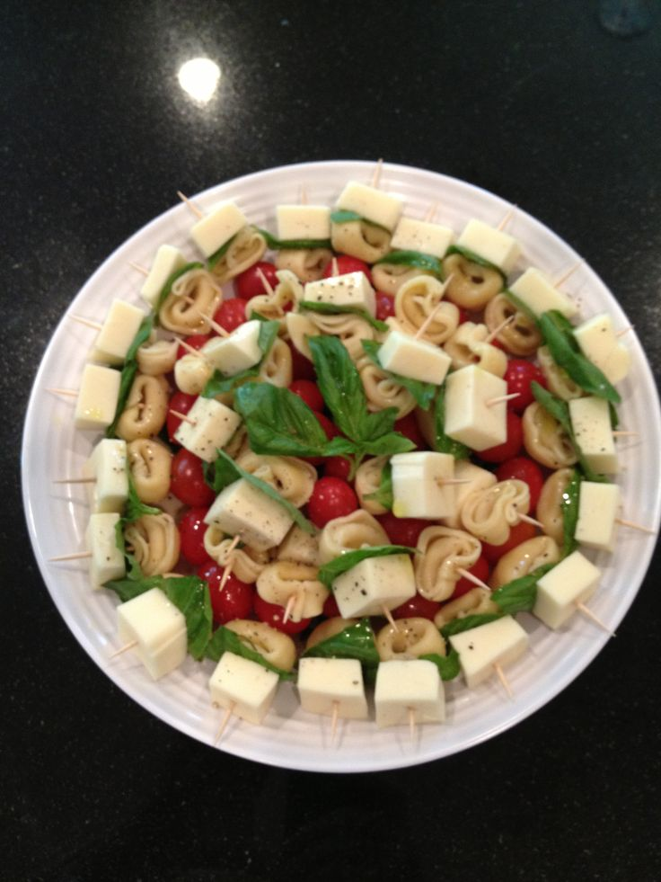 Tortellini Caprese Bites:  On toothpicks, skewer mozzarella cube, fresh basil, tortellini, grape tomato.  Drizzle EVOO, salt and pepper over the top.  They were a hit at the party - both kids and adults loved them.